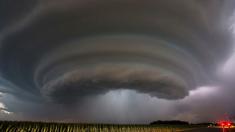 A severe thunderstorm makes its way towards Wichita, Kan., on Tuesday, June, 26, 2018. Multiple storms erupted over south-central Kansas on Tuesday. (Travis Heying/The Wichita Eagle via AP)
