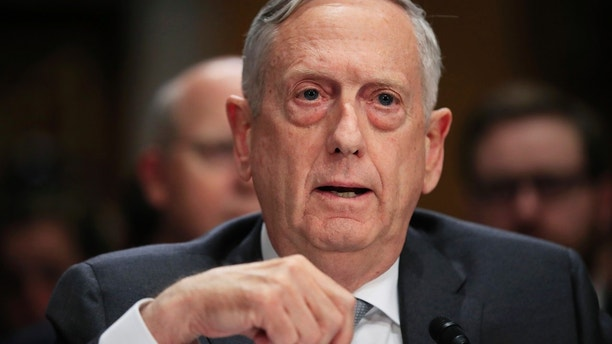 """FILE - In this Oct. 30, 2017, file photo, Secretary of Defense Jim Mattis, testifies during a Senate Foreign Relations Committee hearing on """"The Authorizations for the Use of Military Force: Administration Perspective"""" on Capitol Hill in Washington. A half century after the Tet Offensive punctured American hopes for victory in Vietnam, Mattis is visiting the former enemy to promote closer ties. Mattis will be in Vietnam just days before the 50th anniversary of the Communist offensive on Jan. 30-31, 1968, in which North Vietnam attacked an array of key objectives in the South, including the city of Hue. (AP Photo/Manuel Balce Ceneta, File)"""
