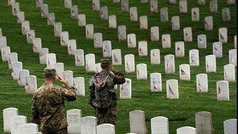 "Soldiers from the 3rd U.S. Infantry Regiment (Old Guard) salute as Taps is heard nearby during ""Flags-in"", where a flag is placed at each of the 284,000 headstones at Arlington National Cemetery, ahead of Memorial Day, in Arlington, Virginia, U.S., May 25, 2017. REUTERS/Kevin Lamarque - RC1350BC2680"