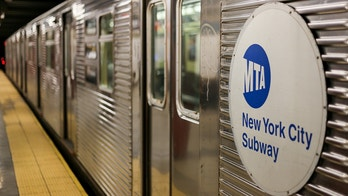 New York City, USA - May 21, 2014: A Subway waits in New York City - the doors are closed.