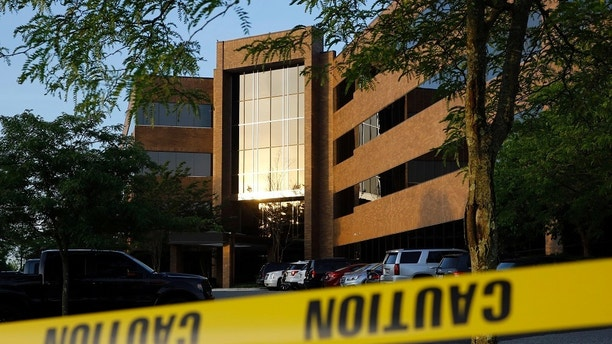 Crime scene tape surrounds a building housing The Capital Gazette newspaper's offices, Friday, June 29, 2018, in Annapolis, Md. A man armed with smoke grenades and a shotgun attacked journalists in the building Thursday, killing several people before police quickly stormed the building and arrested him, police and witnesses said. (AP Photo/Patrick Semansky)