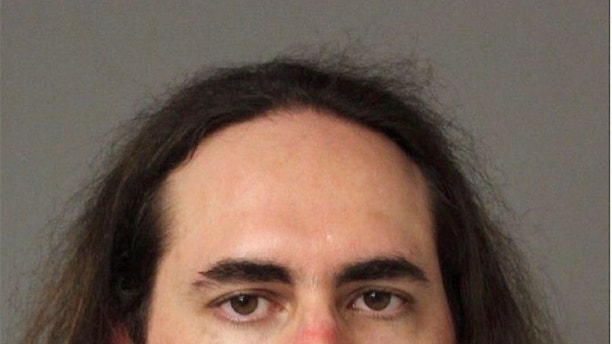 1530290543874 - Capital Gazette shooting suspect barricaded door, preventing staffers from escaping rampage