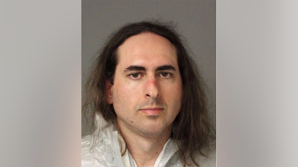 In this June 28 2018 photo released by the Anne Arundel Police, Jarrod Warren Ramos poses for a photo, in Annapolis, Md. First-degree murder charges were filed Friday against Ramos who police said targeted Maryland's capital newspaper, shooting his way into the newsroom and killing four journalists and a staffer before officers swiftly arrested him. (Anne Arundel Police via AP)