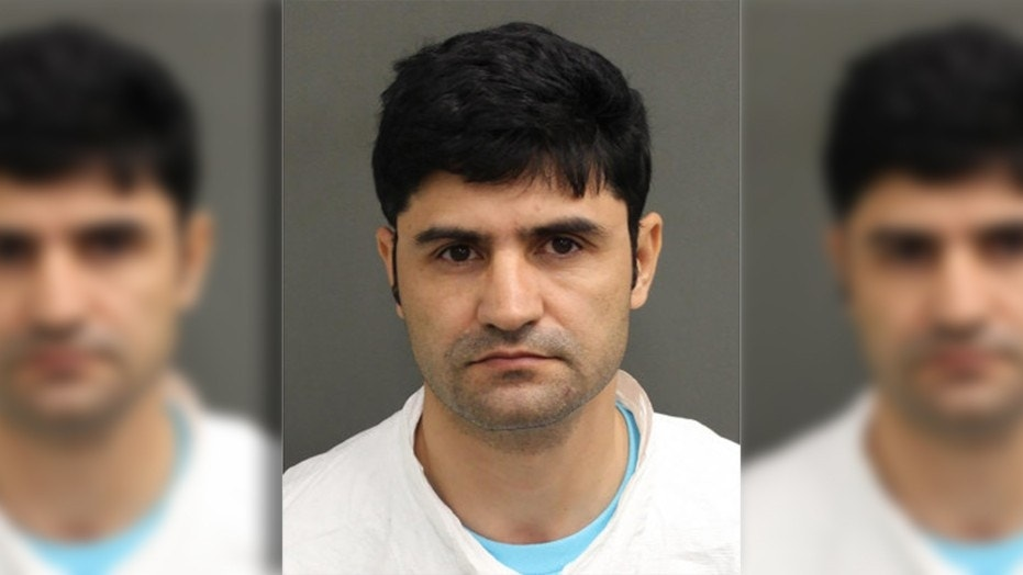 Ali Borji was charged with stalking a student in Florida.