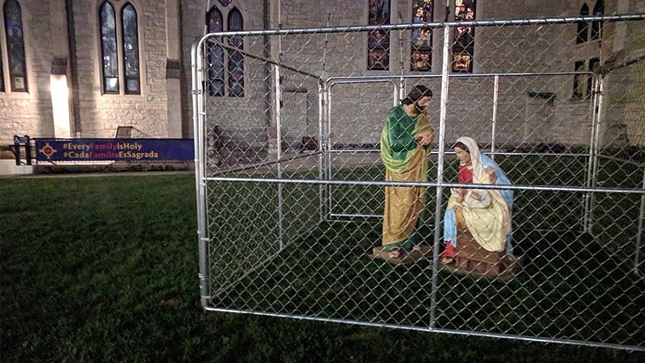 """Christ Church Cathedral in Indianapolis placed figures of Joseph, Mary and baby Jesus in an """"ICE detention"""" cage on its front lawn to protest the Trump administration's immigration policies"""