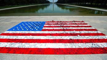 IMAGE DISTRIBUTED FOR THE LEGO GROUP - A 16 ft wide by 31 ft long LEGO® mural of an American flag, built by National Mall visitors is situated on the Lincoln Memorial plaza in support of The Trust for the National Mall event, Monday, July 2 in Washington. (Joy Asico/AP Images for The LEGO Group)