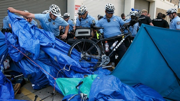 Police confront demonstrators outside the federal Immigration and Customs Enforcement agency on Thursday, July 5, 2018 in Philadelphia.  Several protesters were arrested. (Jessica Griffin /The Philadelphia Inquirer via AP)