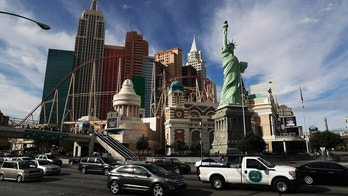"""FILE - This Feb. 21, 2017 file photo shows the New York New York hotel and casino on the Las Vegas Strip. A judge has ordered the U.S. Postal Service to pay $3.5 million to the sculptor of a Statue of Liberty replica at the New-York-New York casino-resort in Las Vegas after an image of the replica was mistakenly used on a stamp.Sculptor Robert Davidson sued the Postal Service for copyright infringement over the """"forever"""" stamp design released in 2011 that featured the face of his Lady Liberty. (AP Photo/John Locher, File)"""