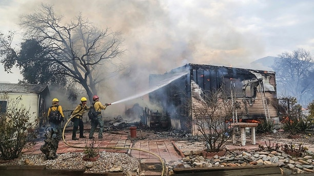 1530980261589 - Firefighters battle to contain wildfires sweeping through California