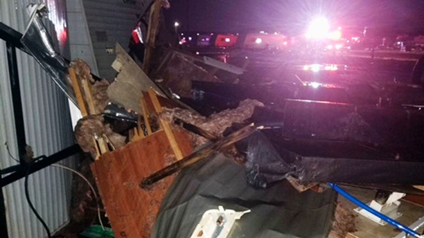 This photo provided by Clifford Bowden shows damage early Tuesday, July 10, 2018, at an RV park in Watford City, N.D., after a violent storm whipped through the northwestern North Dakota city overnight. More than two dozen people were hurt in the storm that overturned recreational vehicles and tossed mobile homes, officials said Tuesday. (Clifford Bowden via AP)