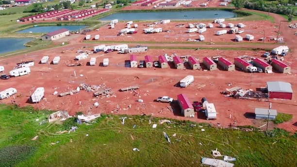 This aerial image from video, shot with a drone provided by HRI Aerial Imaging, shows damage at an RV park Tuesday, July 10, 2018, in Watford City, N.D., after a violent storm whipped through the northwestern North Dakota city overnight. More than two dozen people were hurt in the storm that overturned recreational vehicles and tossed mobile homes, officials said Tuesday. (HRI Aerial Imaging via AP)