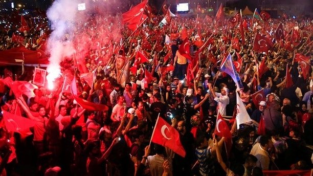 "Crowd cheer as Turkey's President Recep Tayyip Erdogan speaks at the July 15 Martyr's bridge on a ""National Unity March"" to commemorate the one year anniversary of the July 15, 2016 botched coup attempt, in Istanbul, Saturday, July 15, 2017. Turkey commemorates the first anniversary of the July 15 failed military attempt to overthrow president Erdogan, with a series of events honoring some 250 people, who were killed across Turkey while trying to oppose coup-plotters. (AP Photo/Lefteris Pitarakis)"