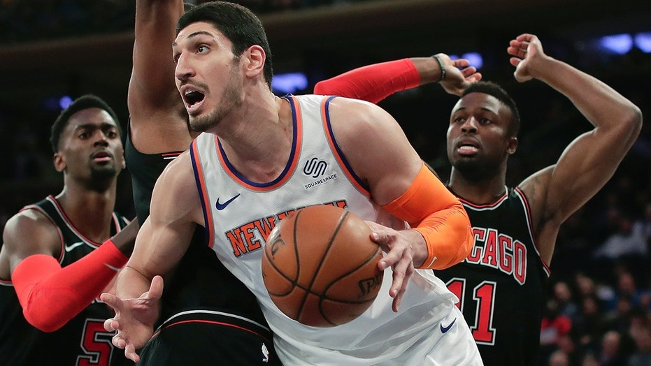 FILE - In this March 19, 2018, file photo, New York Knicks center Enes Kanter (00) drives to the basket against the Chicago Bulls during the first quarter of an NBA basketball game in New York. Kanter informed the Knicks on Friday, June 29, 2018, that he was opting into his contract for next season, rather than becoming a free agent. 