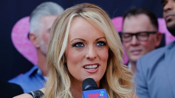 "FILE - In this May 23, 2018 file photo, porn actress Stormy Daniels speaks during a ceremony for her receiving a City Proclamation and Key to the City in West Hollywood, Calif.  Daniels was arrested at an Ohio strip club and is accused of letting patrons touch her in violation of a state law, her attorney said early Thursday, July 12.  While Daniels was performing at Sirens, a strip club in Columbus, some patrons touched her in a ""non-sexual"" way, her lawyer, Michael Avenatti, told The Associated Press. An Ohio law known as the Community Defense Act prohibits anyone who isn't a family member to touch a nude or semi-nude dancer. (AP Photo/Ringo H.W. Chiu, File)"