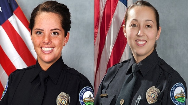 Roswell Police Officers Courtney Brown, left, and Kristee Wilson are on leave after a video surfaced showing the two officers flipping a coin to determine whether or not they should arrest a woman pulled over for speeding in Roswell, Georgia.