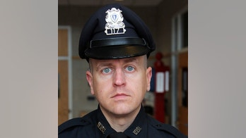 This Dec. 10, 2012 photo shows Weymouth Police Officer Michael C. Chesna in Weymouth, Mass. Chesna died Sunday, July 15, 2018, from wounds sustained when a suspect allegedly took the officer's gun and fired following a vehicle crash and a foot chase. (Gary Higgins/The Quincy Patriot Ledger via AP)