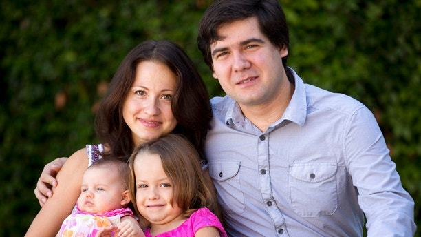 FILE - In this 2014 file photo, concert pianist Vadym Kholodenko, poses with his wife Sofya Tsygankova and daughters, Nika, center, and Michela, at their home in Fort Worth, Texas. On Monday, July 16, 2018, a judge found Tsygankova, Kholodenko's estranged wife, not guilty by reason of insanity in the 2016 deaths of the couple's two daughters. Tsygankova, who was charged with capital murder, was then ordered committed to a state mental hospital. The defense and prosecutors agreed with the ruling. (Joyce Marshall/Star-Telegram via AP, File)