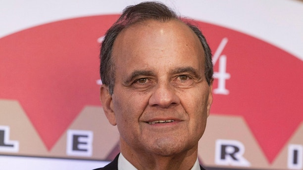 Joe Torre, former MLB manager for the New York Yankees and LA Dodgers, walks the red carpet during Muhammad Ali's Celebrity Fight Night in Phoenix, Arizona, April 12, 2014.  REUTERS/Samantha Sais  (UNITED STATES - Tags: ENTERTAINMENT SPORT BASEBALL) - GM1EA4D0X1R01