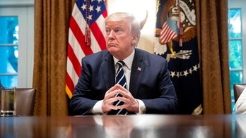 President Donald Trump waits for members of the media get set up before speaking in the Cabinet room of the White House, Tuesday, July 17, 2018, in Washington. Trump says he meant the opposite when he said in Helsinki that he doesn't see why Russia would have interfered in the 2016 U.S. elections.. (AP Photo/Andrew Harnik)
