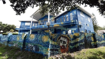 This Wednesday, July 18, 2018 photo shows the painted exterior of the home of Lubomir Jastrzebski and Nancy Memhauseer in Mount Dora, Fla. The Orlando Sentinel reports the Mount Dora City Council unanimously agreed Tuesday, July 17, 2018, that the couple can keep the mural, and the city must pay them $15,000 and remove a property lien to end the nearly yearlong code enforcement case. The dispute began when the couple painted an exterior wall as a way to calm their son, who is autistic and loves van Gogh's work. (AP Photo/John Raoux)