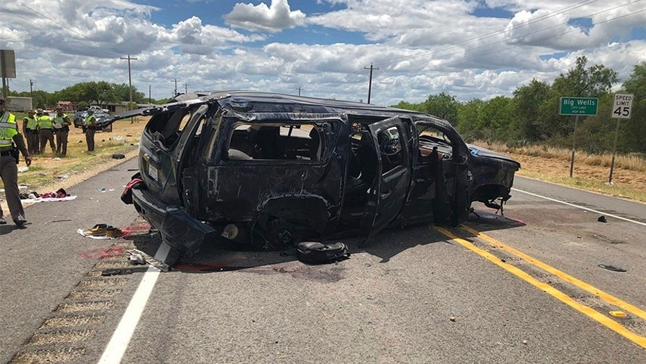 In this image tweeted by David Caltabiano of KABB/WOAI, a heavily damaged SUV is seen on Texas Highway 85 in Big Wells, Texas, after crashing while carrying more than a dozen people fleeing from Border Patrol agents.