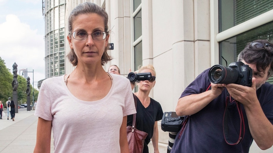 Clare Bronfman, left, leaves federal court, Tuesday, July 24, 2018, in the Brooklyn borough of New York.