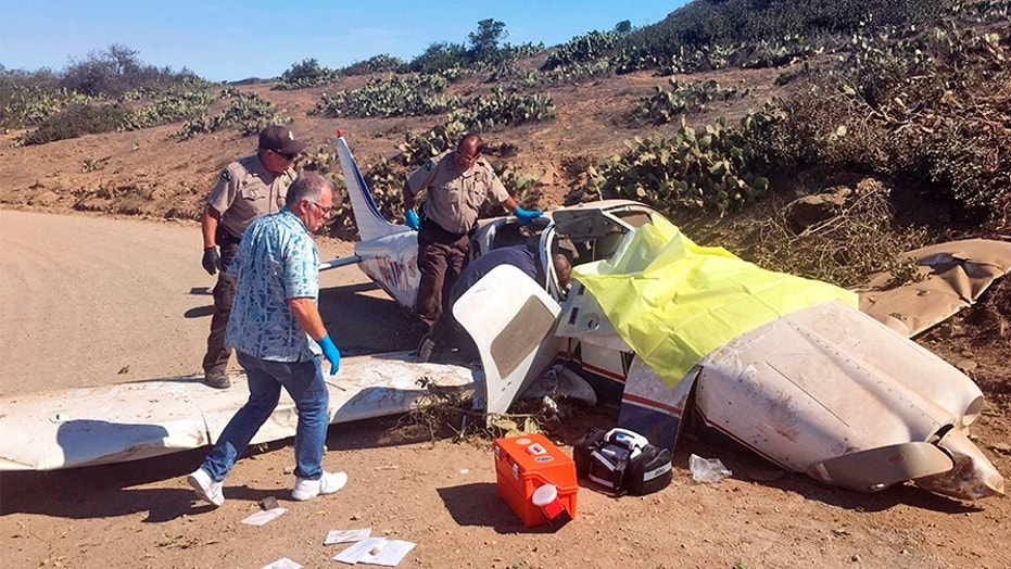 First responders investigate the scene of a plane crash Wednesday at the airport near Avalon on Santa Catalina Island off the coast of Southern California.