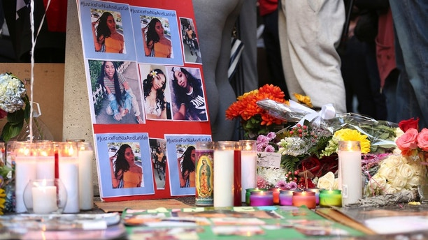 A memorial for 18-year-old Nia Wilson takes shape outside Bay Area Rapid Transit's MacArthur Station, Monday, July 23, 2018, a day after she was fatally stabbed on a platform at the station, in Oakland, Calif. (AP Photo/Lorin Eleni Gill)