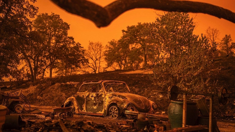 In this July 27, 2018 photo, a Volkswagen Beetle scorched by a wildfire called the Carr Fire rests at a residence in Redding, Calif.