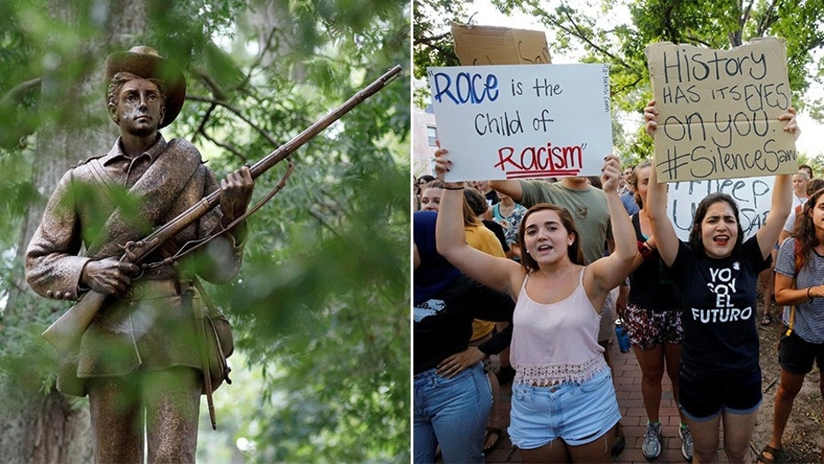 Students rallying for the removal of a statue of a Confederate soldier nicknamed Silent Sam on the campus of the University of North Carolina at Chapel Hill in August 2017.