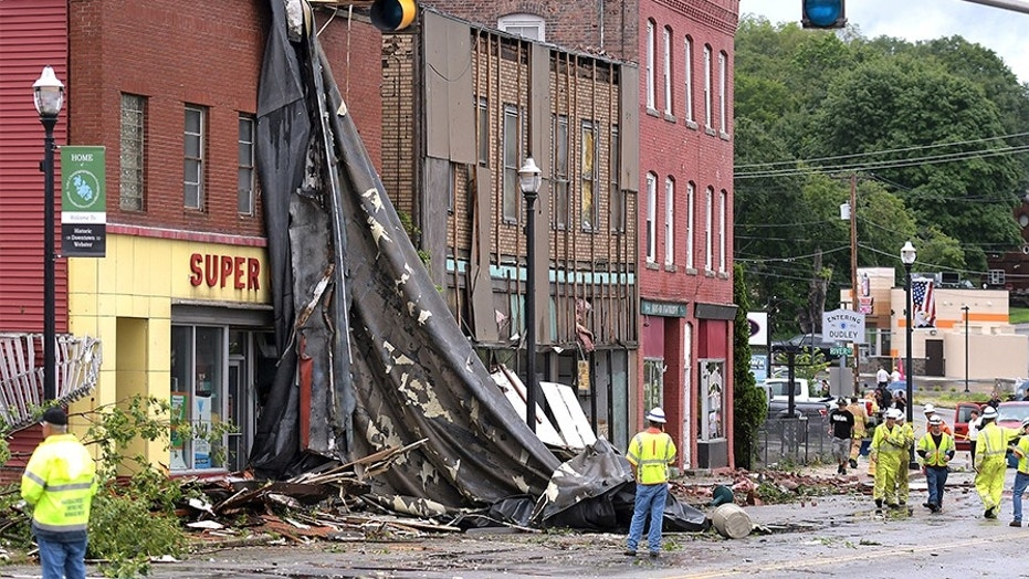 A building suffers damage to its roof after a storm passed on Saturday in Webster, Mass. Officials say a tornado touched down in the Massachusetts town near the Connecticut border. The National Weather Service confirmed the tornado but didn't know its strength. The tornado caused structural damage to buildings and downed trees and poles.