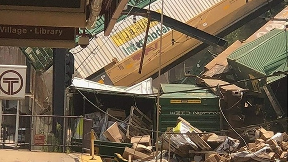 Seven rail cars from a freight train derailed in Pittsburgh, sending shipping containers tumbling down a hillside onto light rail tracks below, but no injuries have been reported, authorities said.