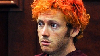 FILE - In this July 23, 2012, file photo, James Holmes, who was convicted of killing 12 moviegoers and wounding 70 more in a shooting spree in a crowded theatre in 2012, sits in Arapahoe County District Court in Centennial, Colo. In a new book and an interview with The Associated Press, psychiatrist William H. Reid, who spent hours talking with Holmes, says what led Holmes to open fire was a vortex of his mental illness, his personality and his circumstances, along with other, unknown factors. (RJ Sangosti/The Denver Post via AP, Pool, File)