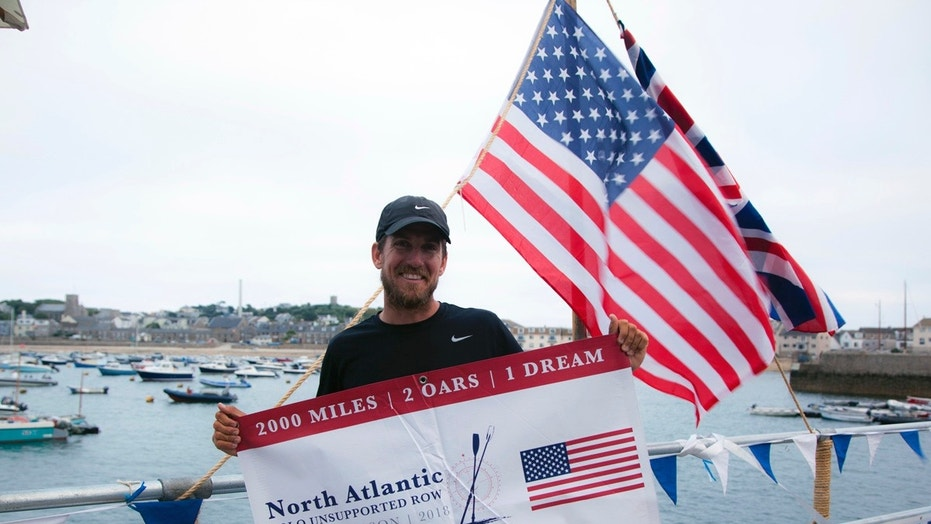 Bryce Carlson poses for a photo after completing his solo unsupported row across the Atlantic, at St. Mary's Harbour, Isle of Scilly, England.