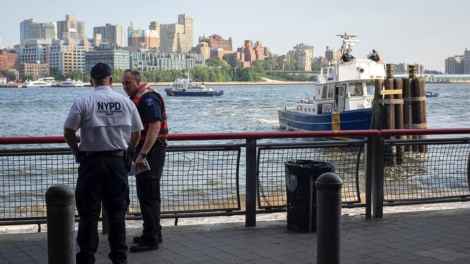 Authorities investigate the death of a baby boy who was found floating in the water near the Brooklyn Bridge in Manhattan