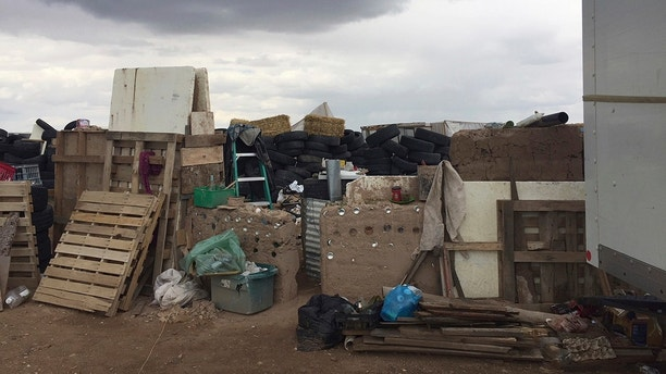 This Friday, Aug. 3, 2018, photo released by Taos County Sheriff's Office shows a rural compound during an unsuccessful search for a missing 3-year-old boy in Amalia, N.M. Law enforcement officers searching the compound for the missing child didn't locate him but found 11 other children in filthy conditions and hardly any food, a sheriff said Saturday. The children ranging in age from 1 to 15 were removed from the compound and turned over to state child-welfare workers, Taos County Sheriff Jerry Hogrefe said.in Taos, N.M. (Taos County Sheriff's Office via AP)