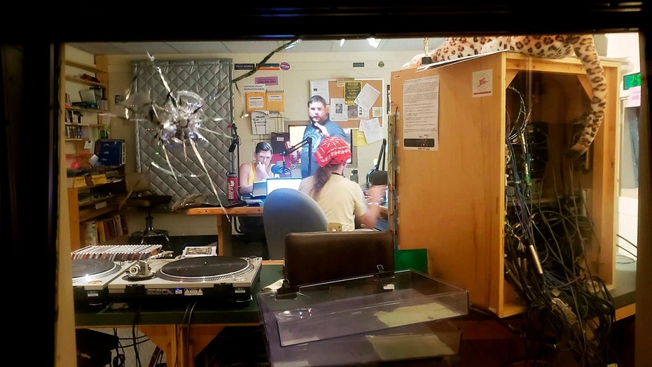 A bullet hole is seen in a studio window at community radio station WORT-FM in Madison, Wis., after an early morning shooting by an intruder left one of the station's disc jockeys with non-life threatening injuries.