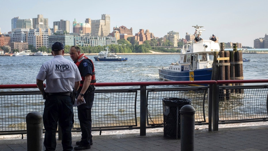The father of a 7-month-old baby carrying him in a backpack before tossing the boy's body into the East River on Sunday, Aug. 5.