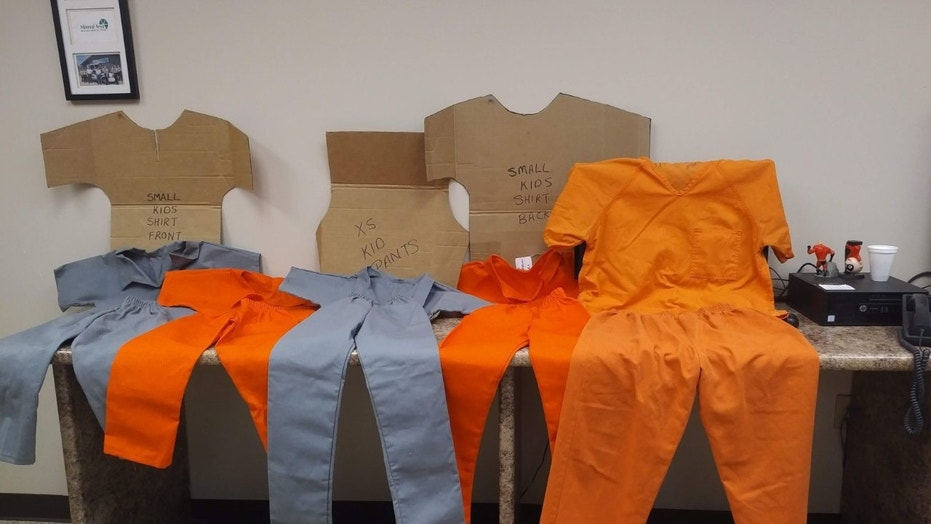At left are small prisoner uniforms that authorities say Laura Cheatham ordered for the four adopted children living in her home. At right is an adult-size uniform added for comparison.