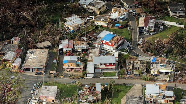 FILE PHOTO: Buildings damaged by Hurricane Maria are seen in Lares, Puerto Rico, October 6, 2017. REUTERS/Lucas Jackson/File Photo - RC16ECE38760