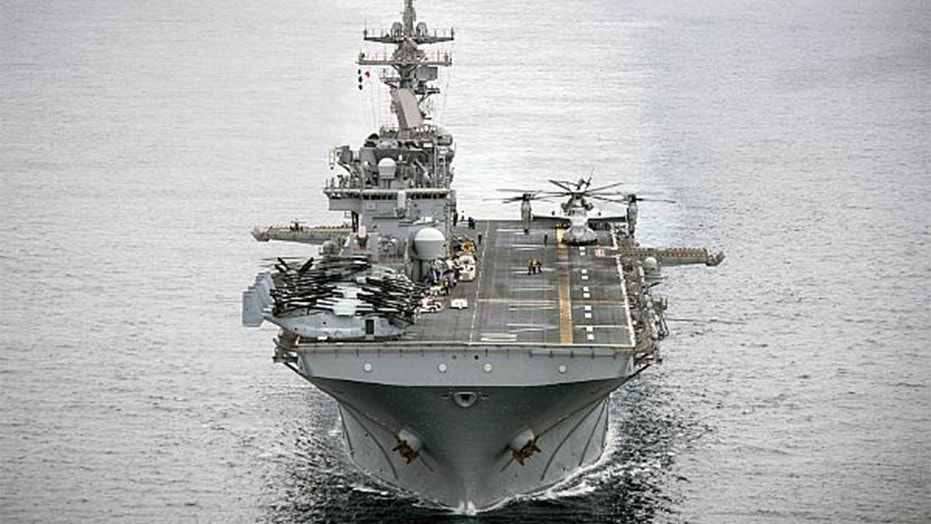 The USS Essex in the Pacific Ocean in April. The Navy says Marine went overboard on the ship Thursday.