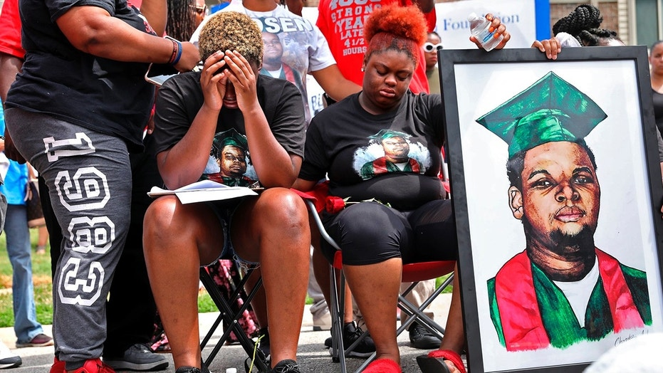 Trinetta, mid-left, 19, and Triniya Brown are emotionally shot during a memorial service for their brother Michael Brown on Thursday, August 9, 2018, at the Canfield Green apartment complex in Ferguson, Missouri, where Brown was shot and killed by the Former police officer Ferguson Darren Wilson four years ago. (Cristina M. Fletes / St. Louis Post-Dispatch via AP)