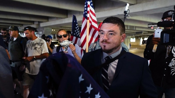 White nationalist Jason Kessler arrives at the Vienna metro station in Vienna, Va., Sunday, Aug. 12, 2018. White nationalists are gathering in Washington on the first anniversary of their rally in Charlottesville.  (AP Photo/Sait Serkan Gurbuz)