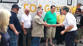 In this Thursday, July 26, 2018 photo, Westport tech entrepreneur and Navy veteran Steve Obsitnik, right, one of five Republicans running for governor, meets with voters in Waterford, Conn., during a campaign event ahead of the Aug. 14 primary. Obsitnik, who was stationed at the U.S. Naval Submarine Base in Groton, said he's been campaigning for a while in eastern Connecticut, where many communities voted for Donald Trump. (AP Photo/Susan Haigh)