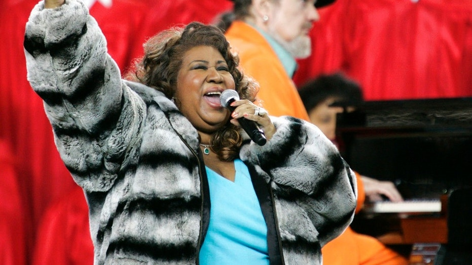 FILE - In this Feb. 5, 2006 file photo, Aretha Franklin and Dr. John, background on piano, perform the national anthem before the Super Bowl XL football game in Detroit. Franklin died Thursday, Aug. 16, 2018 at her home in Detroit.  She was 76. (AP Photo/Gene J. Puskar, File)