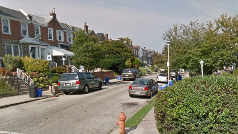 Kristian Marche was shot in the head Monday night outside his home on this block in Philadelphia.