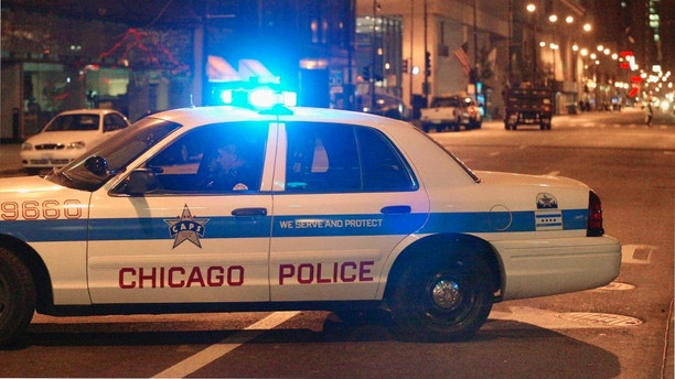 CHICAGO, IL - OCTOBER 17:  A Chicago Police car protects a street near the Cook County administration building October 17, 2003 in downtown Chicago, Illinois. Authorities say at least six people were killed and 10 injured in a fire in the administration building. (Photo by Tim Boyle/Getty Images)