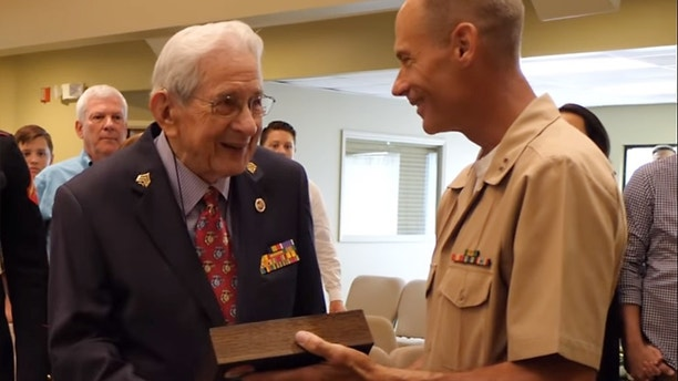 Cpl. Edgar Harrell, marine veterinarian, was eventually promoted to sergeant 73 years later