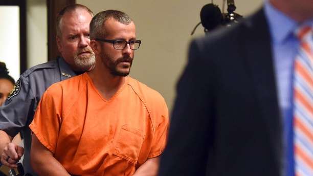 Christopher Watts is escorted into the courtroom before his bond hearing at the Weld County Courthouse on Thursday, Aug. 16, 2018, in Greeley, Colo. Watts, of Colorado, whose wife and daughters disappeared this week was arrested on suspicion of killing them. (Joshua Polson/The Greeley Tribune via AP, Pool)