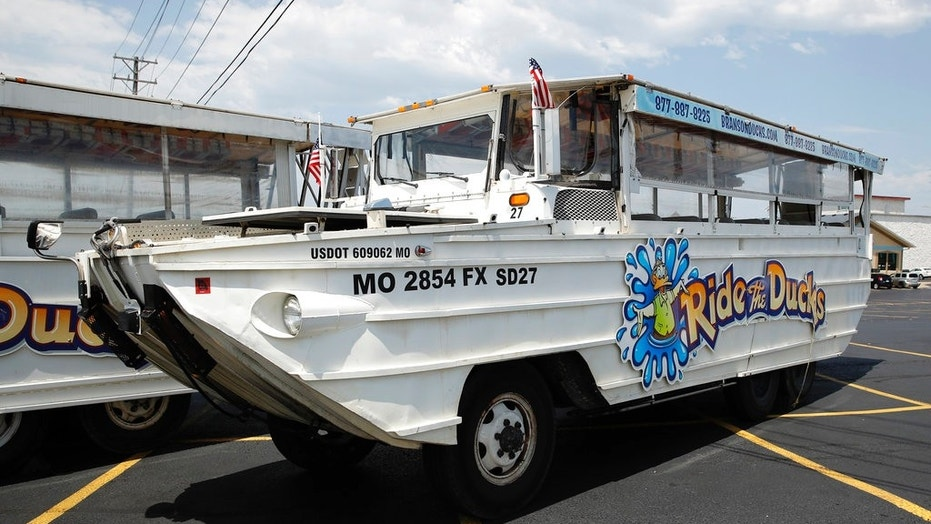 A duck boat sits idle in the parking lot of Ride the Ducks, an amphibious tour operator in Branson, Mo., July 20, 2018.